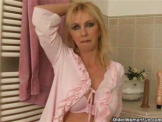 Curvy old woman with large bumpers dildoing in washroom